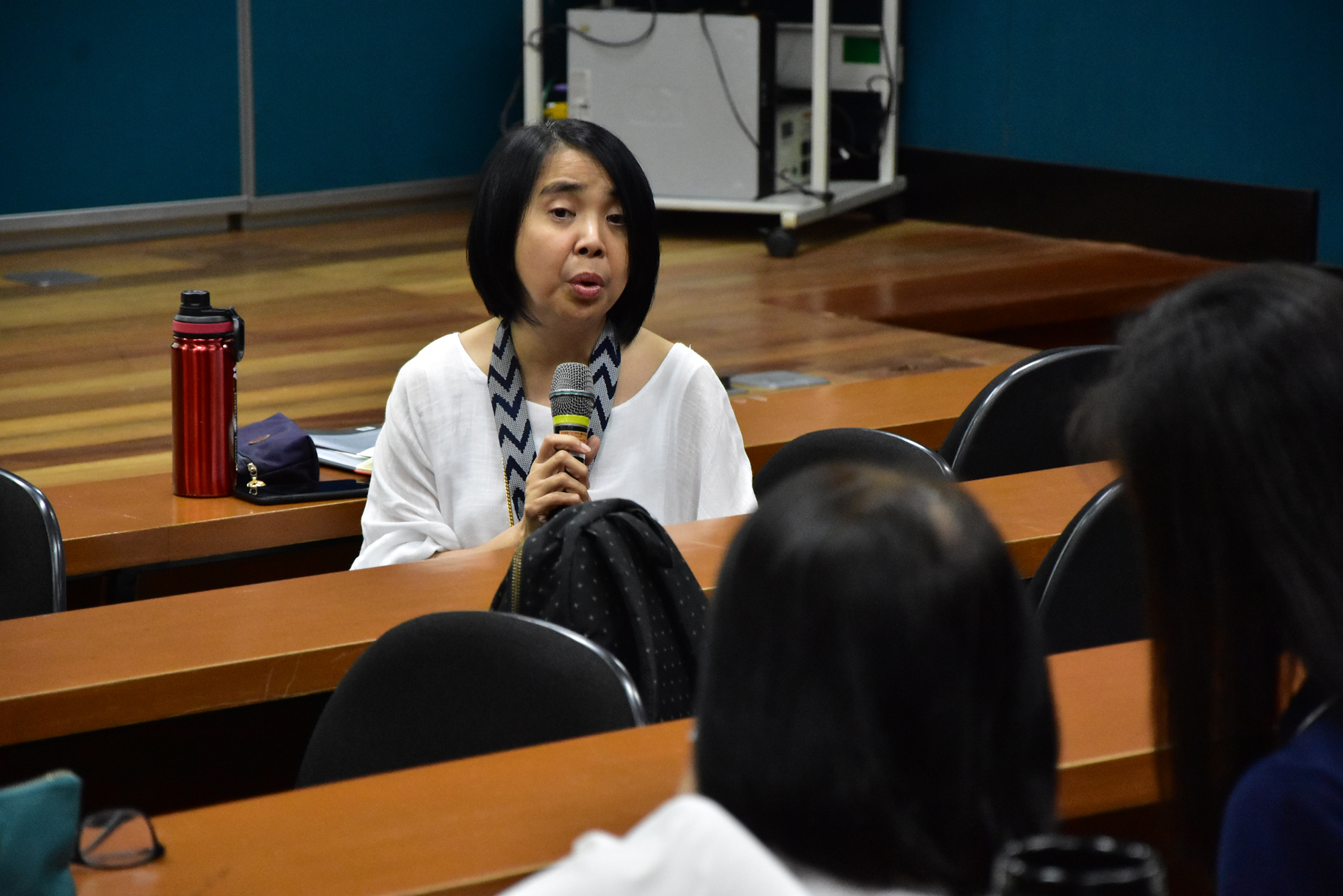Dr. Jasmin Nario-Galace, Vice President for Academic Affairs (VPAA) commenting during the open forum