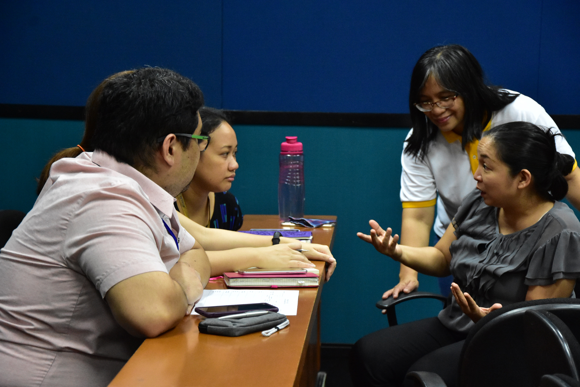 BEU faculty with Ms. Celeste Matias of the MC Research Council, facilitating the writing of their unit research plan.