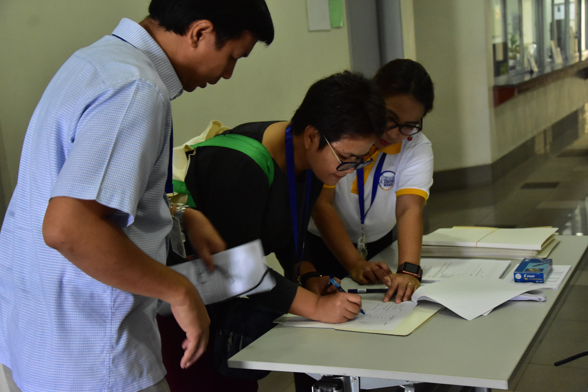 Ms. Villanueva, CSR Program Coordinator assisting during registration